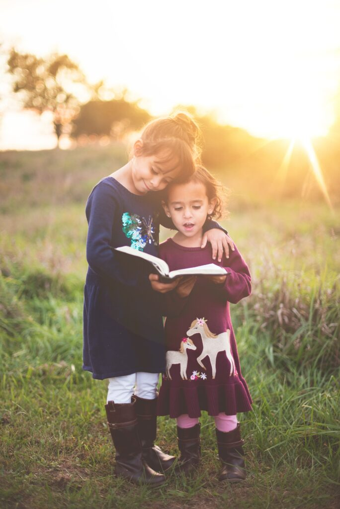 Children's Book Author-2 little girls reading